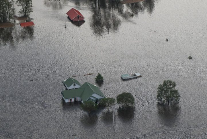 A flooded house stands in the wake of a hurricane.