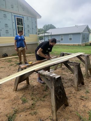 Logan Klein works at a Habitat for Humanity site during the first Gillings Day of Service.