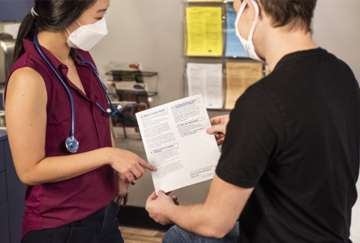 A health care provider shares vaccine information with a patient.